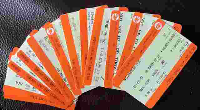 A stack of train tickets fanned out like playing cards.