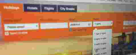 A blurred screenshot of the top part of a travel booking website